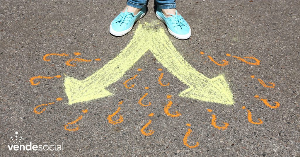 A person stands at the crossroads of two arrows drawn on the ground in chalk   create action from your leads